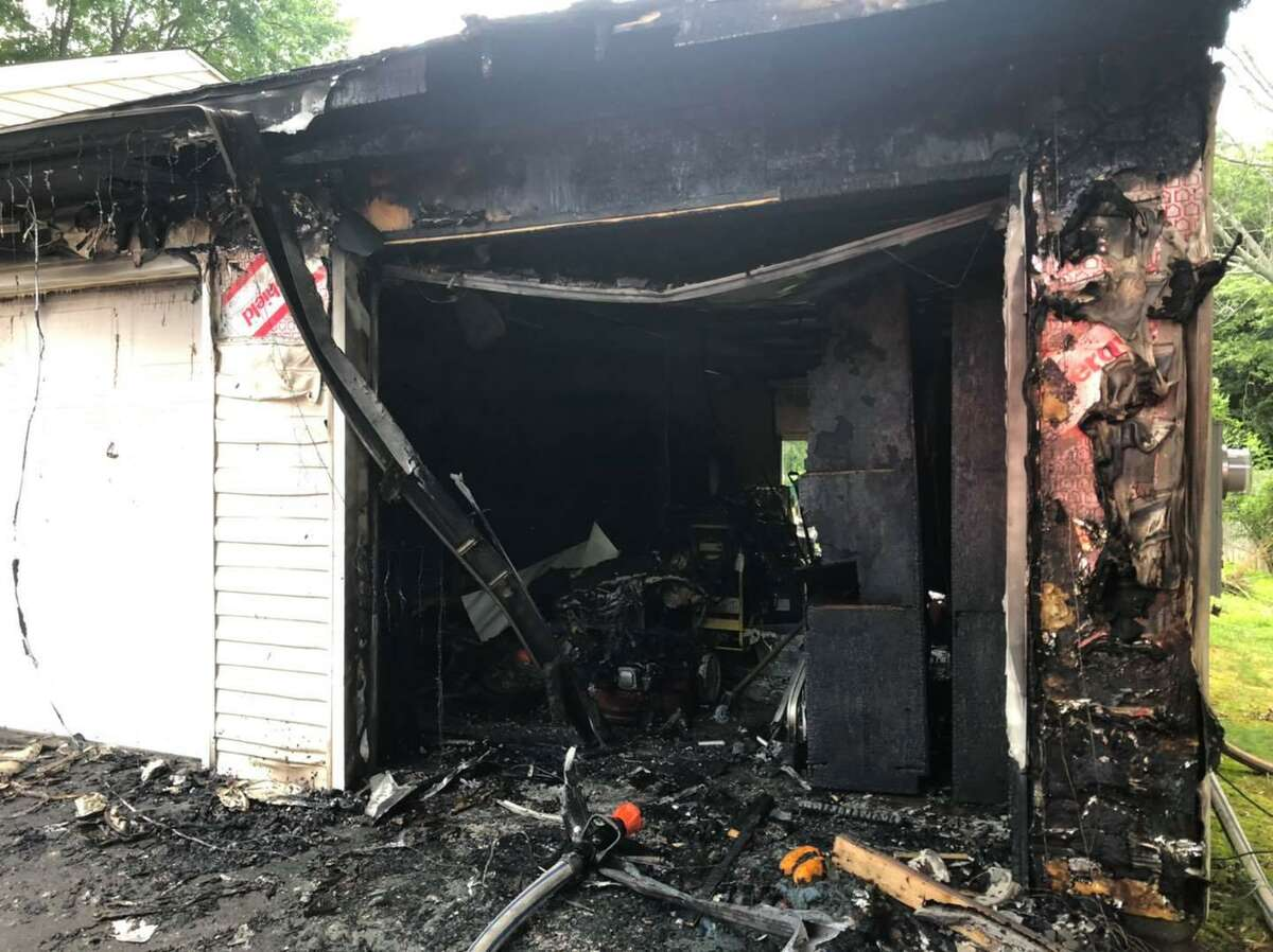 An attached garage at a Bradley Street home in East Hartford, Conn., after a fire on Saturday, July 17, 2021.