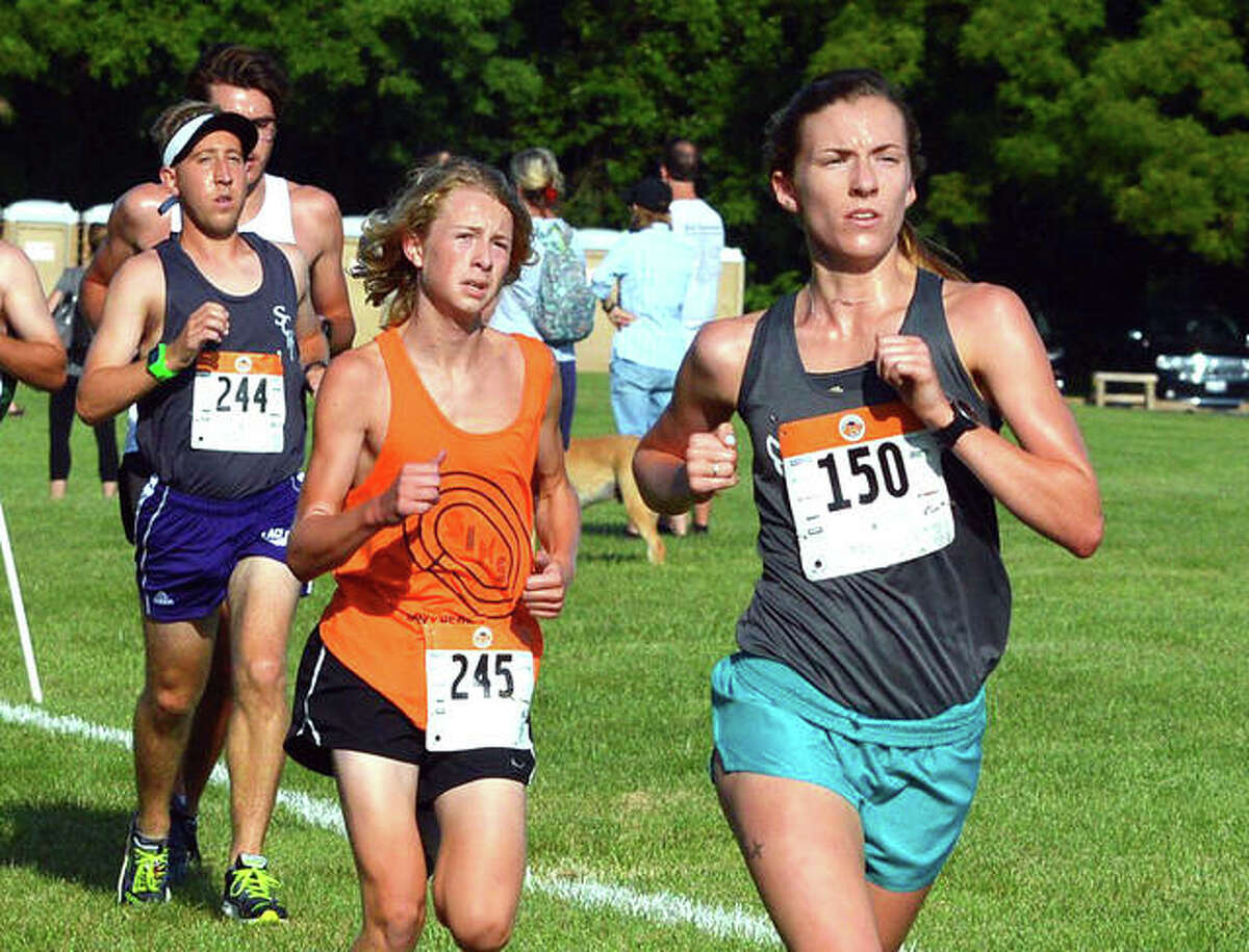 Former EHS runner Julianna Determan, right, competes in the Mud Mountain 5K in 2019 at the SIUE and EHS cross country course. Determan was the women's division champion.