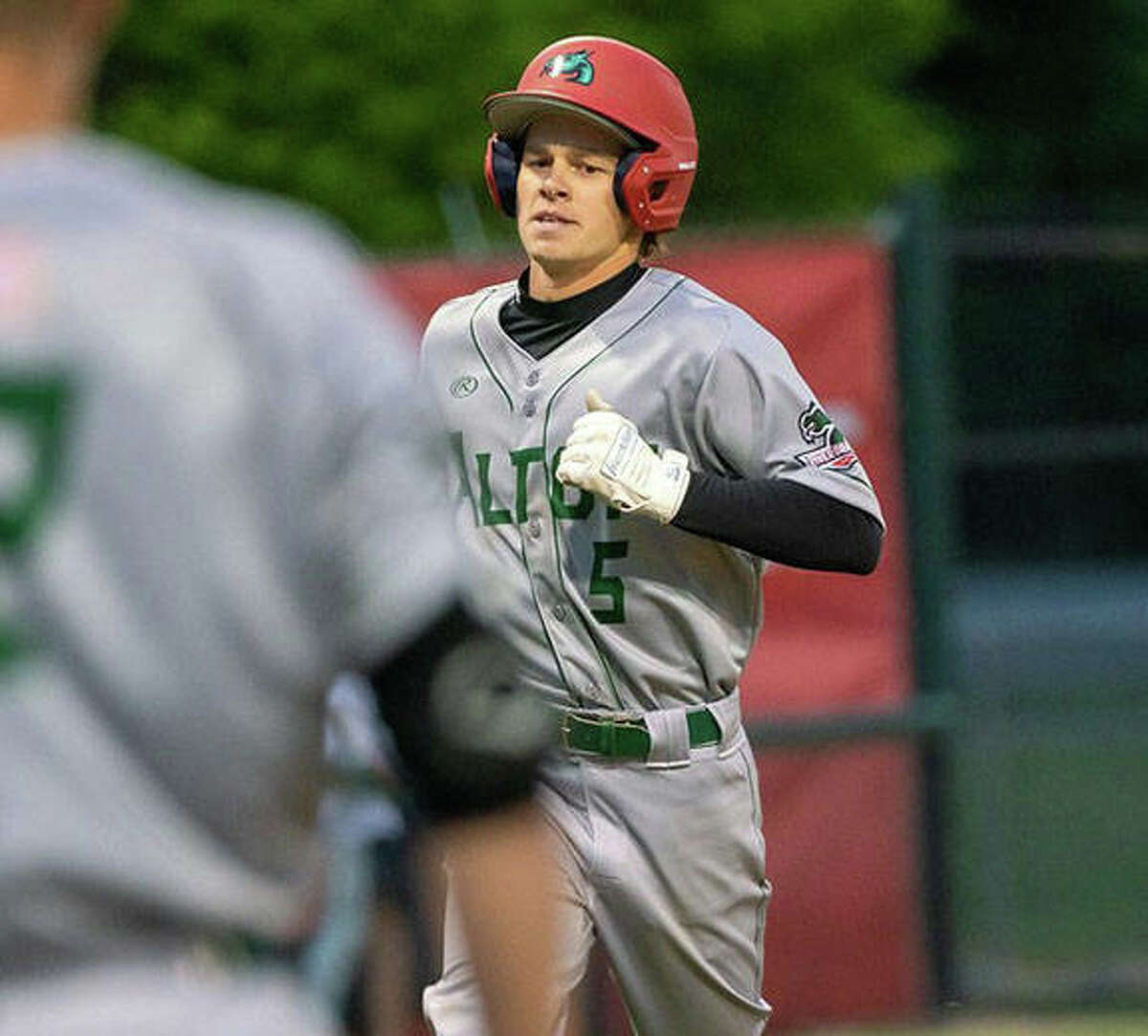 Blake Burris scored one of the two Alton River Dragons runs in an 8-2 loss to the Cape Catfish Sunday night in Cape Girardeau. Burris scored on a single by Brady Mutz.
