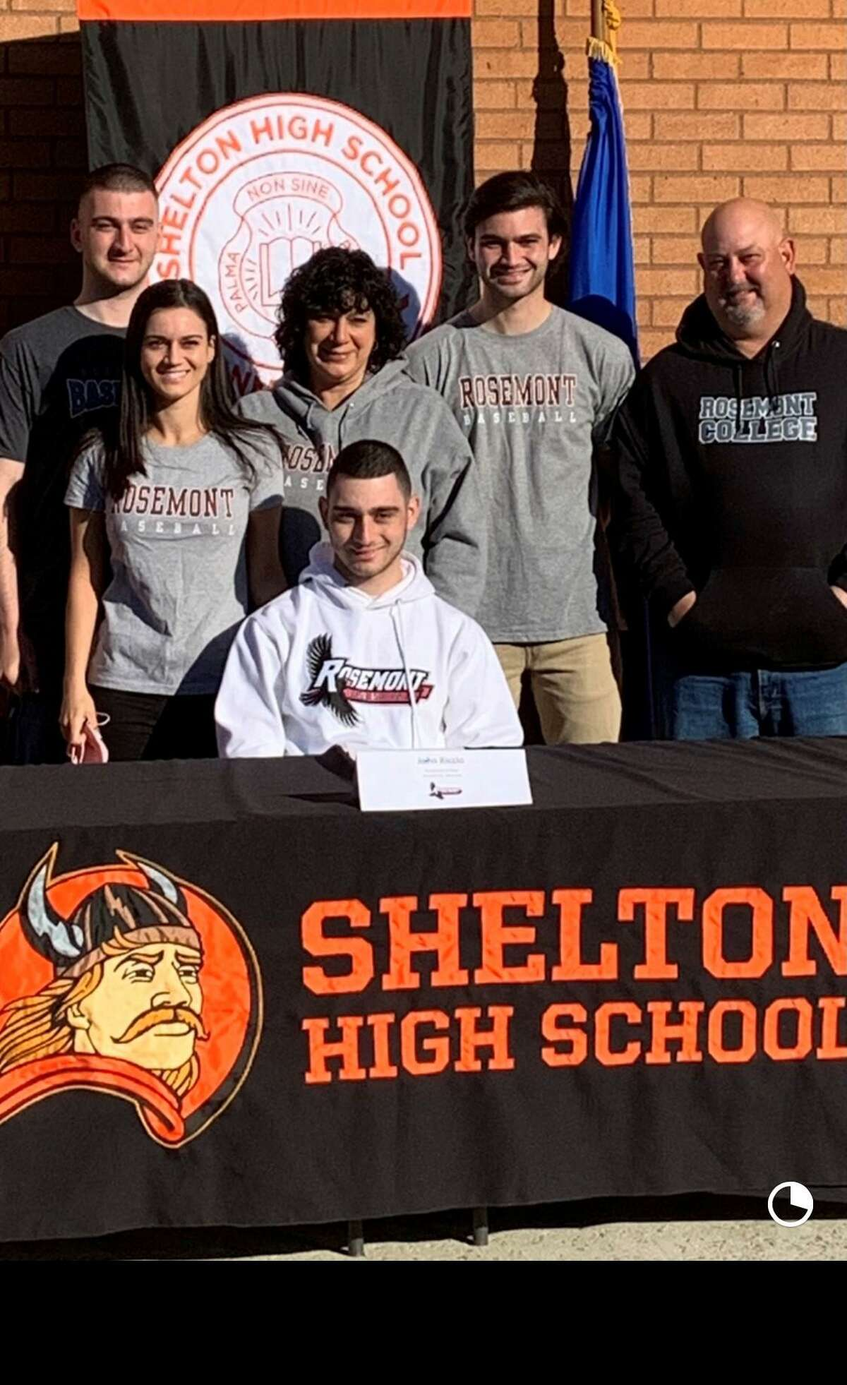 John Riccio signed to play baseball at Rosemont College in Pennsylvania in a ceremony at Shelton High. Joining him were brother Luke, sister Mikayla, mom Lucille, brother Michael and dad Mike.