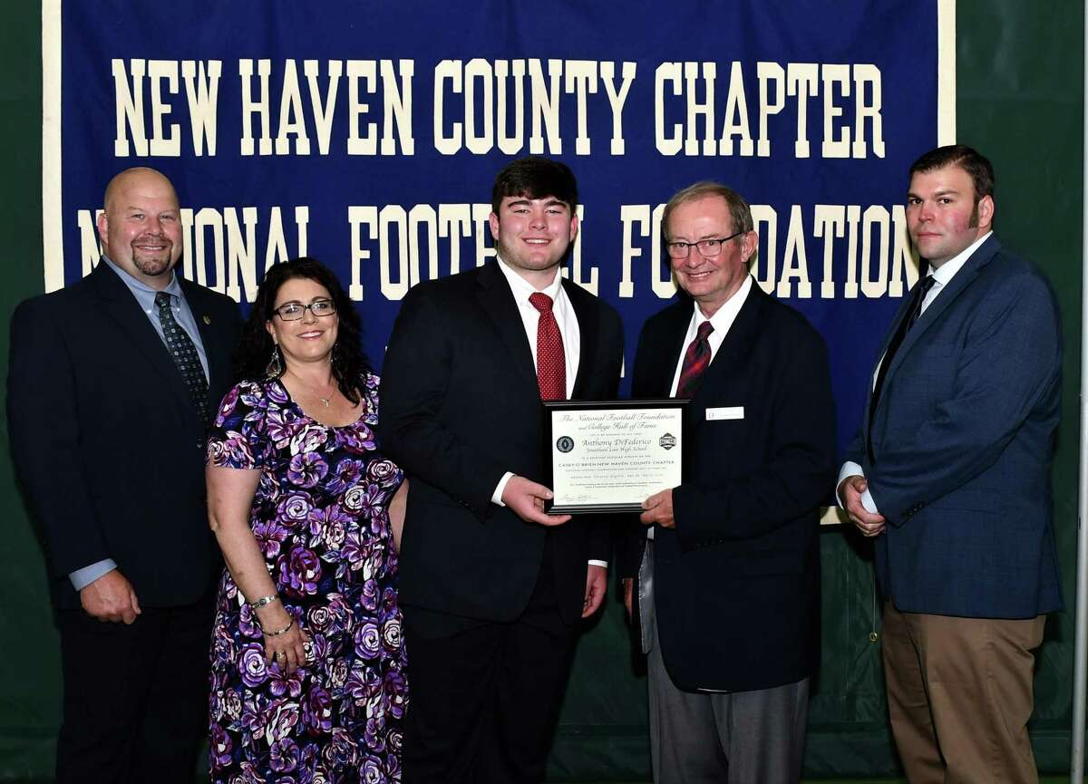 Jonathan Law football player Anthony DiFederico, with his parents John and Denise, scholar athlete chairman Kevin O'Brien and Law coach Chris Haley, was honored for his academic and athletic achievements by the Casey-O'Brien New Haven County Chapter of the National Football Foundation and College Hall of Fame.