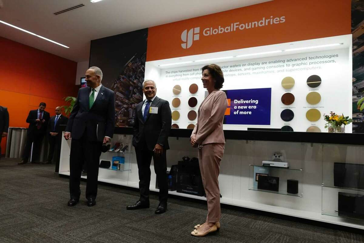 U.S. Senator CharlesSchumer, GlobalFoundries CEO Tom Caulfield,and U.S. Commerce Secretary Gina Raimondoappear at the company's headquarters in Malta on Monday, July 19, 2021.