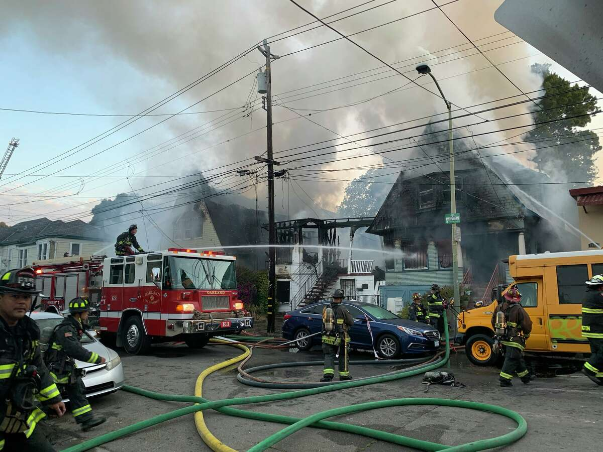 A fire near West Oakland BART on the morning of July 19, 2021, extensively damaged three homes.