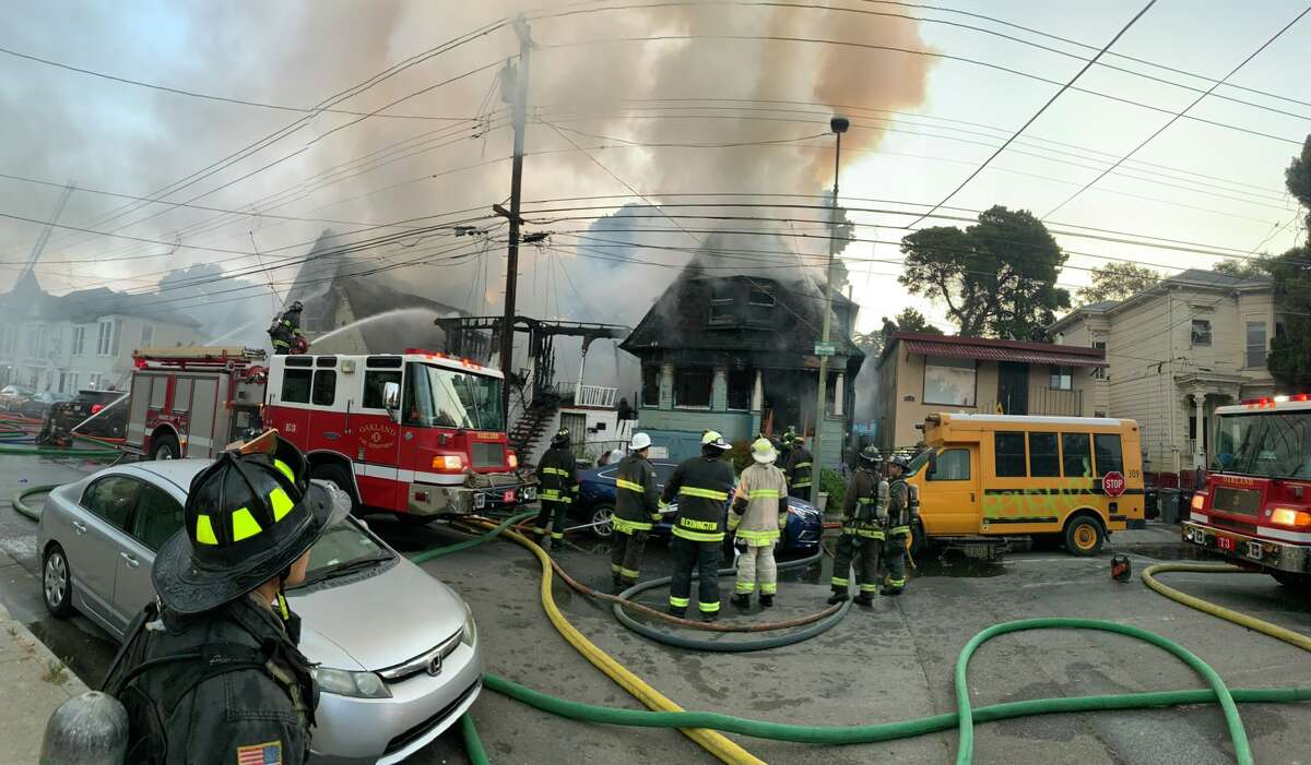 A fire near West Oakland BART on the morning of July 19, 2021, severely damaged three homes.