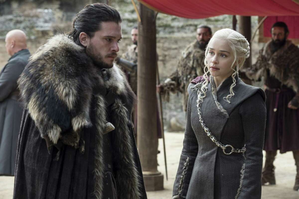 """In this image released by HBO, Kit Harington and Emilia Clarke appear in a scene during the seventh season of """"Game of Thrones."""" (Macall B. Polay / HBO via AP)"""