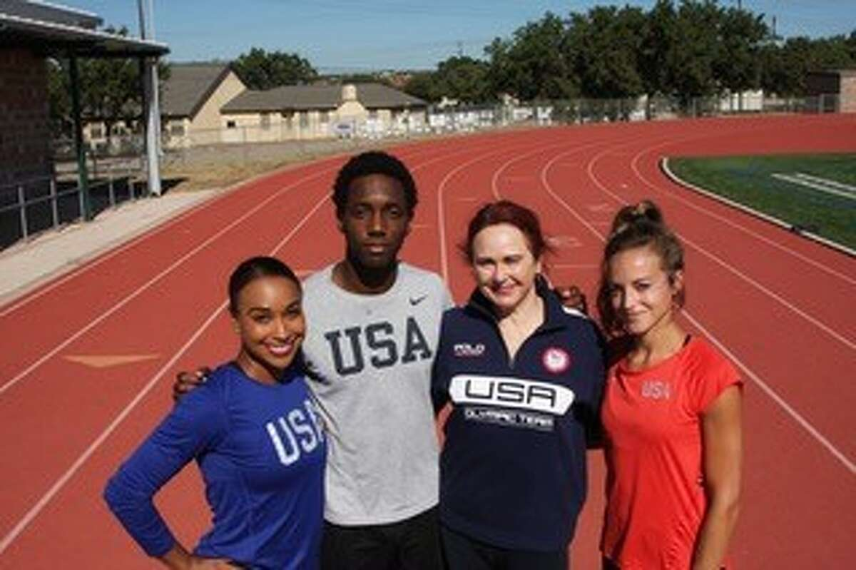 Runners, from left, Kendra Chambers, Myles Marshall, Olympic head track and field coach Rose Monday and Laura Roesler during training in San Antonio in 2020.