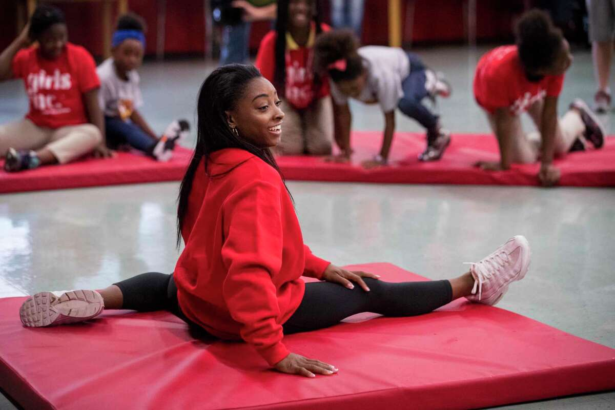 Olympic gold medalist Simone Biles, speaking on fitness, diet and sleep to a group of girls at Nathaniel Q. Henderson Elementary School last year, has an ability to connect with younger athletes.