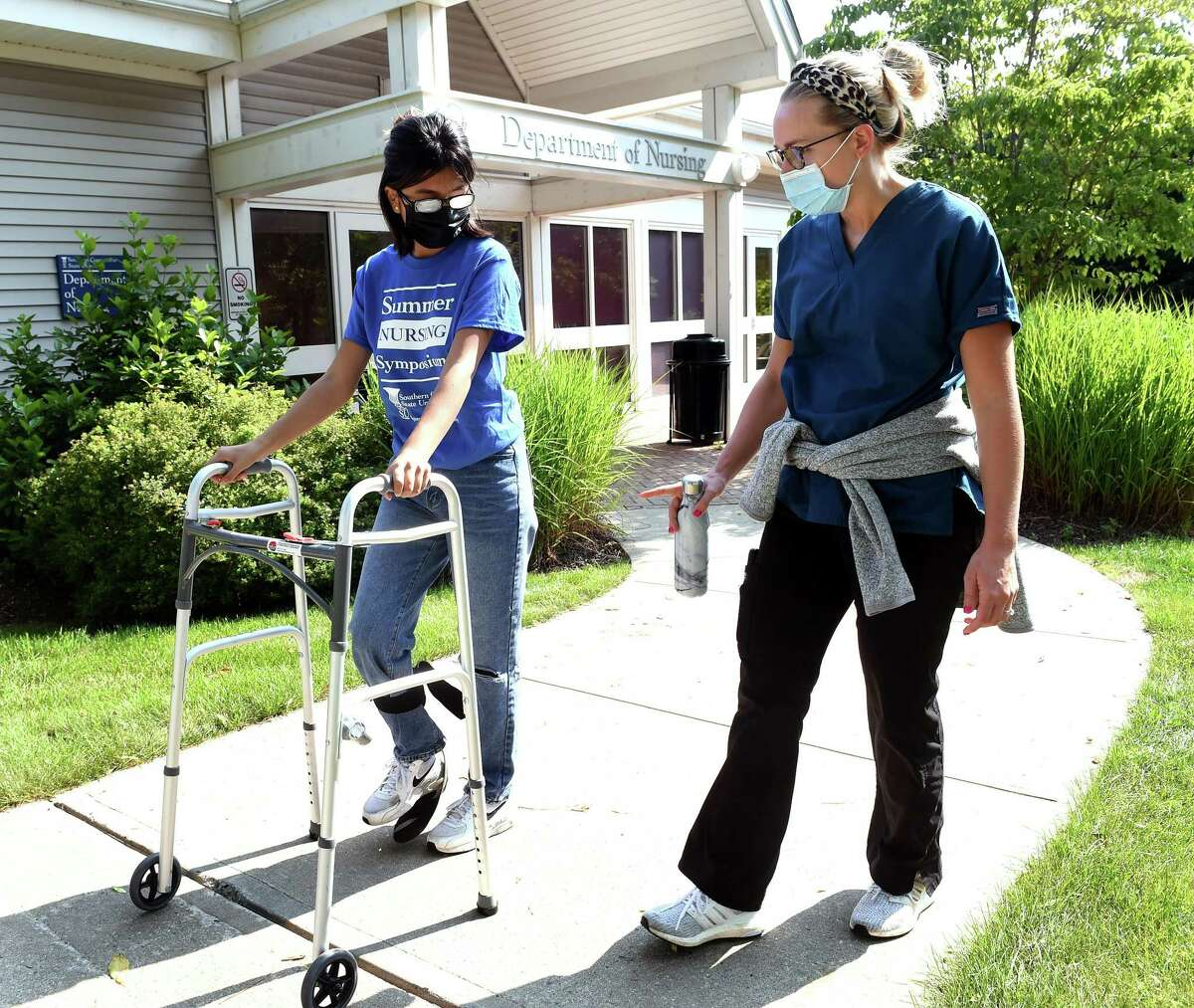 Paulette Jara, left, 16, of New Haven participates in a simulation of having a mobility disability and cataracts with RNC Alyssa Glasow during the Summer Nursing Symposium at Southern Connecticut State University on July 15, 2021. Jara was part of a group of 14 New Haven students of color being exposed to nursing through simulations and shadowing.