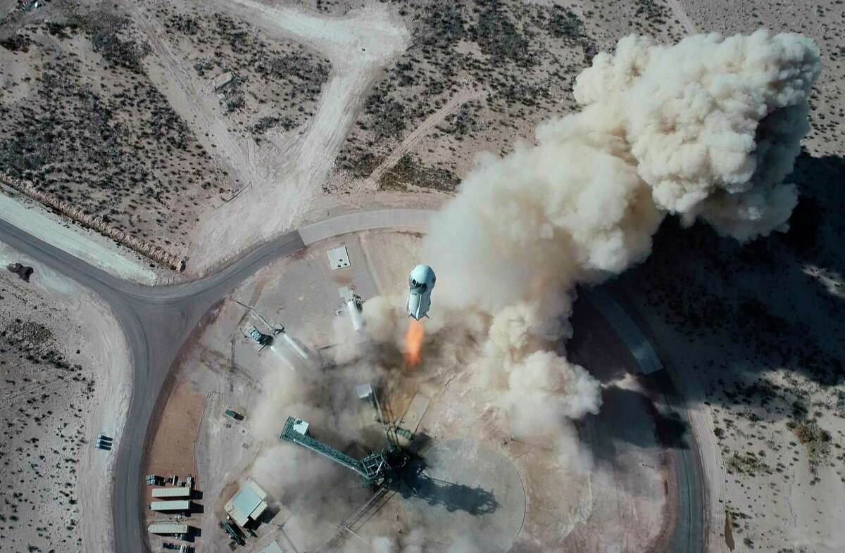 In this Jan. 14, 2021 photo made available by Blue Origin, the New Shepard NS-14 rocket lifts off from Launch Site One in West Texas. (Blue Origin via AP)