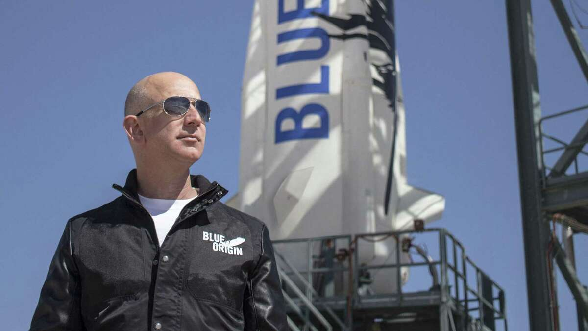 This handout photo taken on April 24, 2015 obtained courtesy of Blue Origin shows Jeff Bezos, founder of Blue Origin, at New Shepard's West Texas launch facility before the rocket's maiden voyage. (Photo by - / BLUE ORIGIN / AFP)