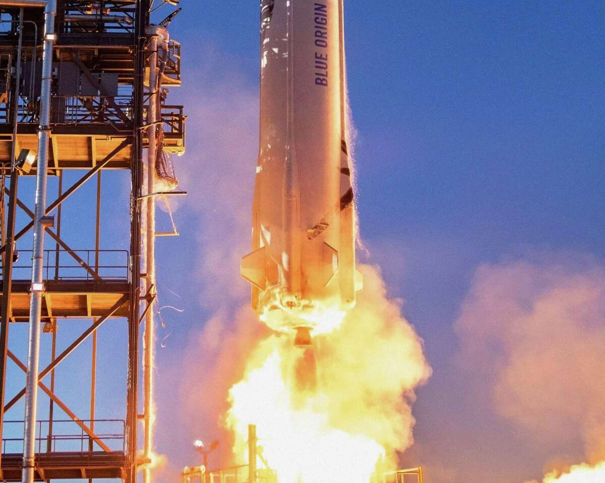 This undated handout photo obtained May 19, 2021, courtesy of Blue Origin, shows a close-up of the New Shepard rocket as it launches in West Texas. (Photo by HANDOUT/BLUE ORIGIN/AFP via Getty Images)