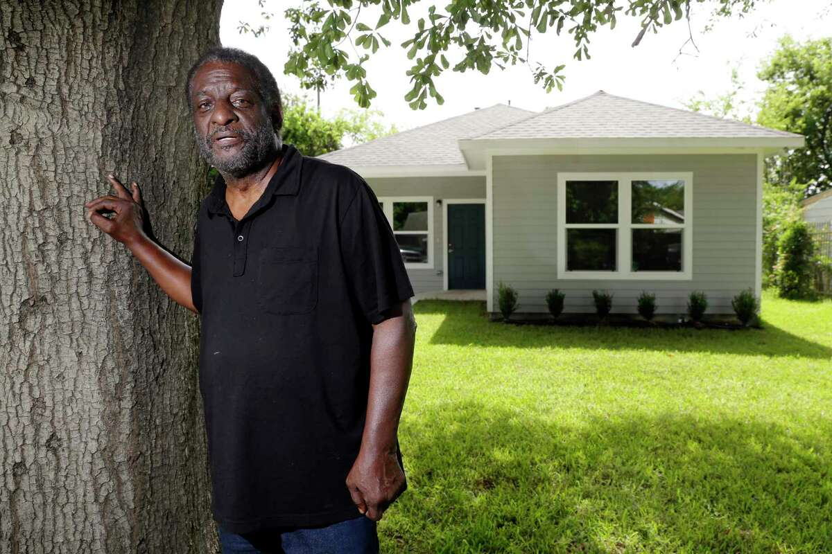 Fred Hamilton, whose home has been rebuilt, says that his new home - built without a garage - is nice, but that the six months between moving out of his old house and into the new one drained his savings.
