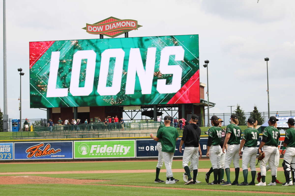 Loons players celebrate after defeating the Lansing Lugnuts on July 11 at Dow Diamond.