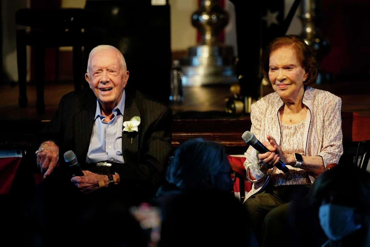 Former President Jimmy Carter and his wife, former First Lady Rosalynn Carter, sit together during a reception to celebrate their 75th anniversary July 10, 2021, in Plains, Ga.
