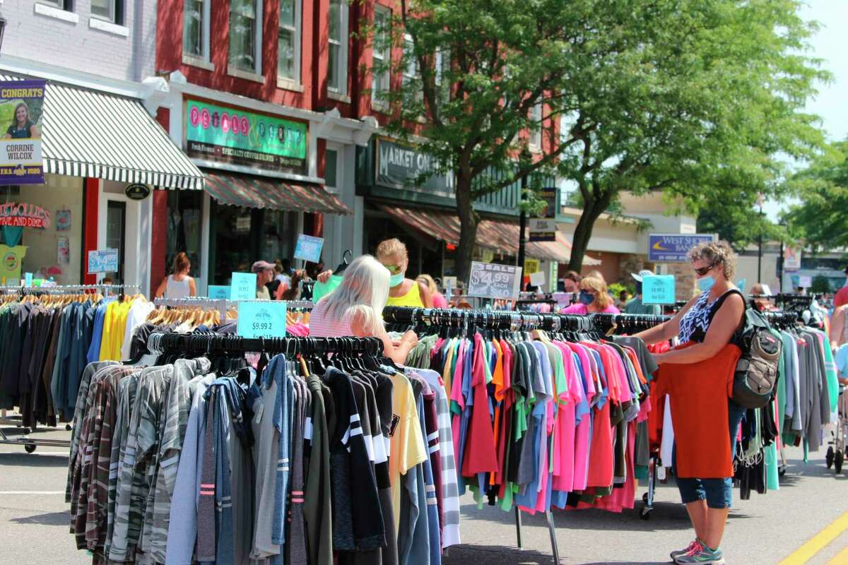 A visitor to Frankfort's Street Sale checks out discounted clothing from one of Frankfort's many downtown businesses. (File Photo)