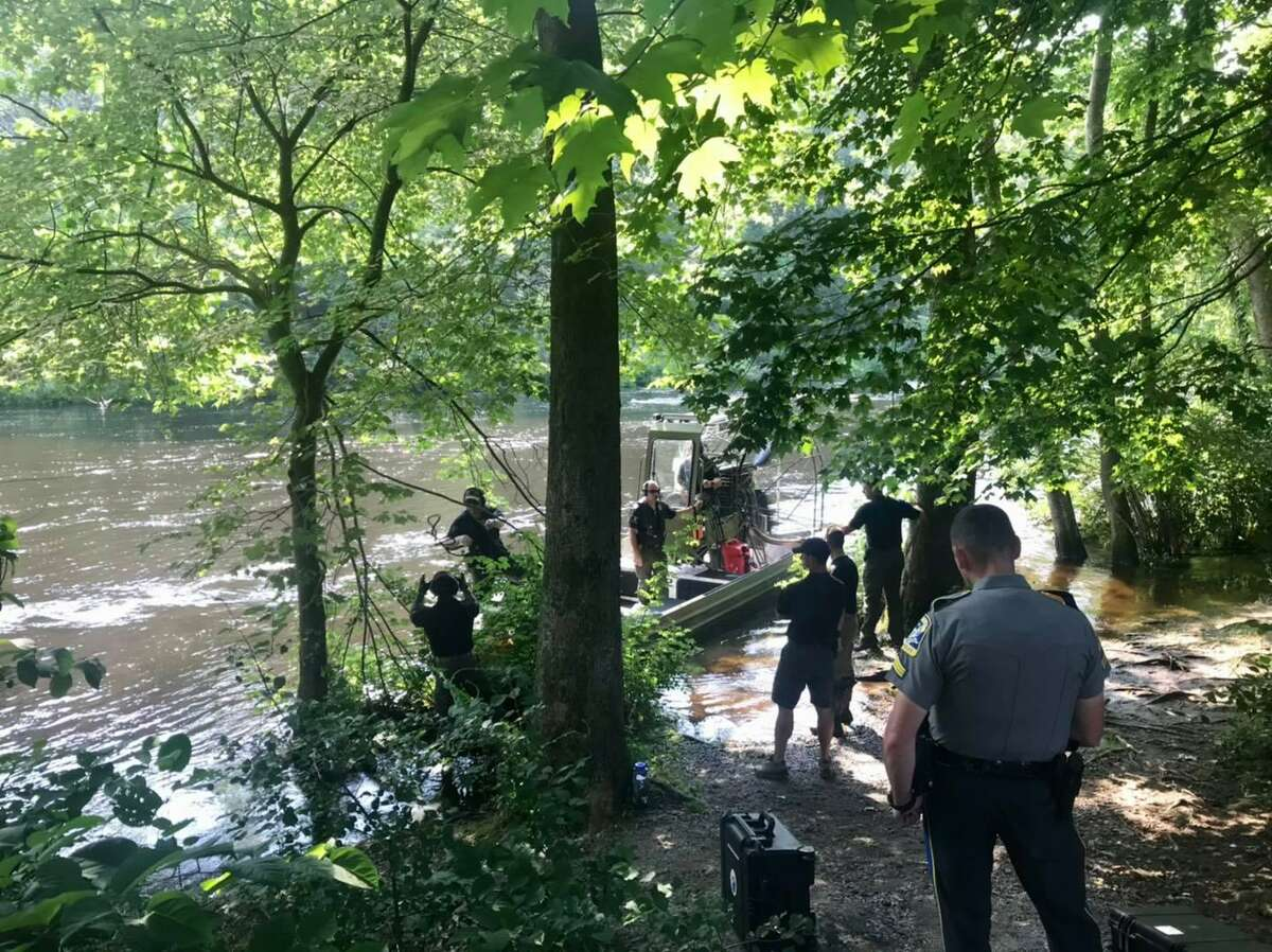 Crews searching the Farmington River in Avon, Conn., for missing two missing swimmers on Friday, July 16, 2021. The search continued throughout the weekend, but was suspended late Sunday morning due to bad conditions on the river.