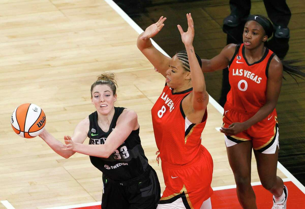 LAS VEGAS, NEVADA - JUNE 27: Katie Lou Samuelson #33 of the Seattle Storm passes under pressure from Liz Cambage #8 of the Las Vegas Aces as Jackie Young #0 of the Aces defends during their game at Michelob ULTRA Arena on June 27, 2021 in Las Vegas, Nevada. The Aces defeated the Storm 95-92 in overtime. NOTE TO USER: User expressly acknowledges and agrees that, by downloading and or using this photograph, User is consenting to the terms and conditions of the Getty Images License Agreement. (Photo by Ethan Miller/Getty Images)