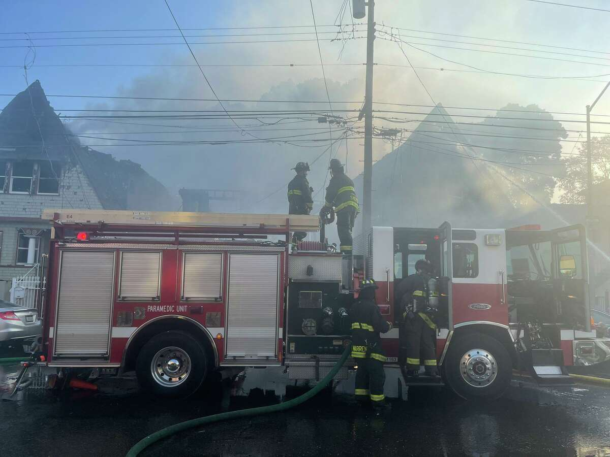 Oakland firefighters at the scene of a three-alarm fire that destroyed several homes in West Oakland. No injuries were reported.