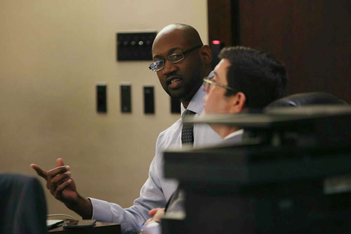 Defendant Otis McKane sits with his attorneys prior to the start of the sixth day of his capital murder trial before Judge Ron Rangel in the Bexar County 379th District Court, Monday, July 19, 2021. McKane is accused in the murder of San Antonio Police Department Detective Benjamin Marconi on Nov. 20, 2016.