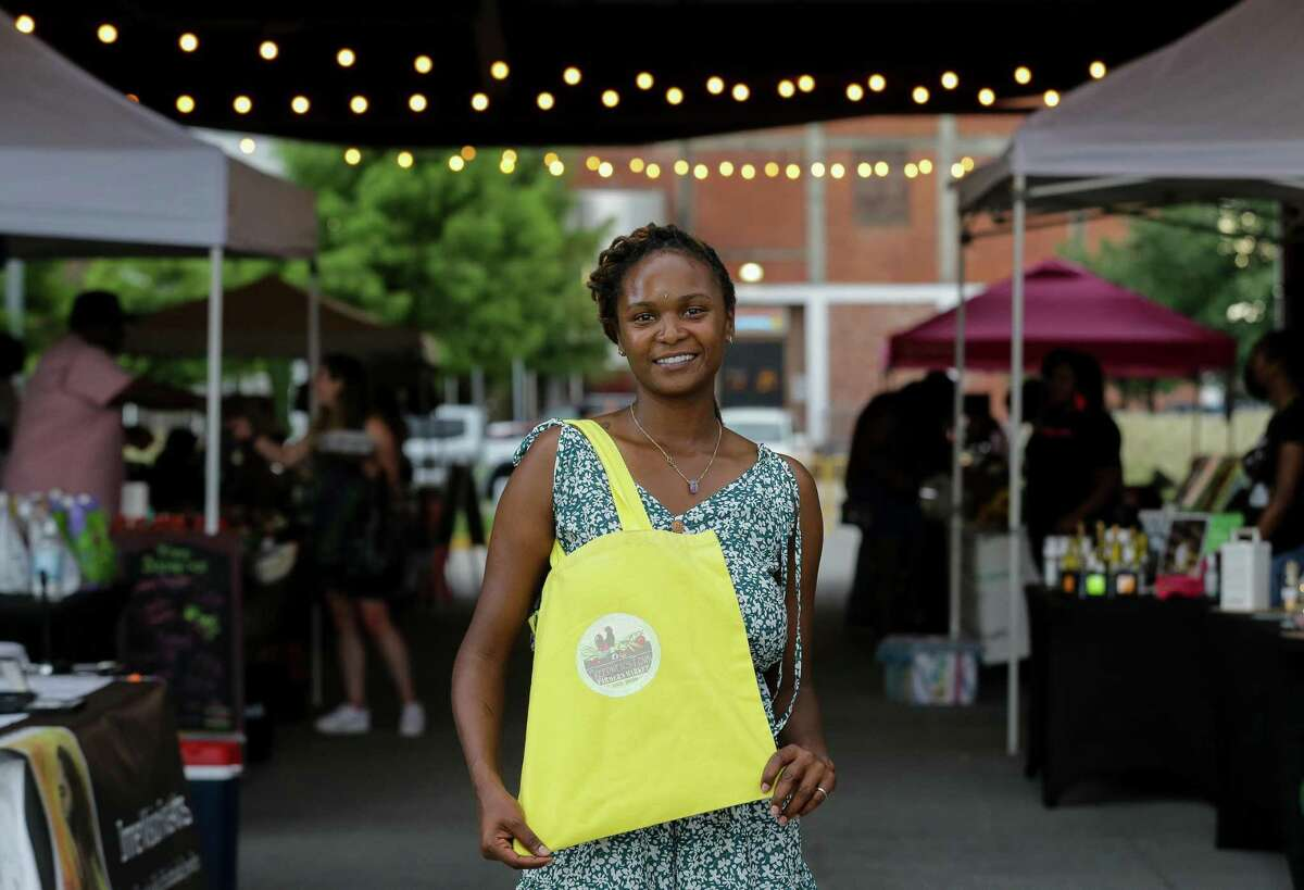 Sade Perkins poses for a photograph at the Lyons Ave Night Market, which she organizes, outside Saint Arnold Brewery on Thursday, July 15, 2021, in Houston. The market happens every Thursday, with more than 20 vendors selling food, crafts and more.
