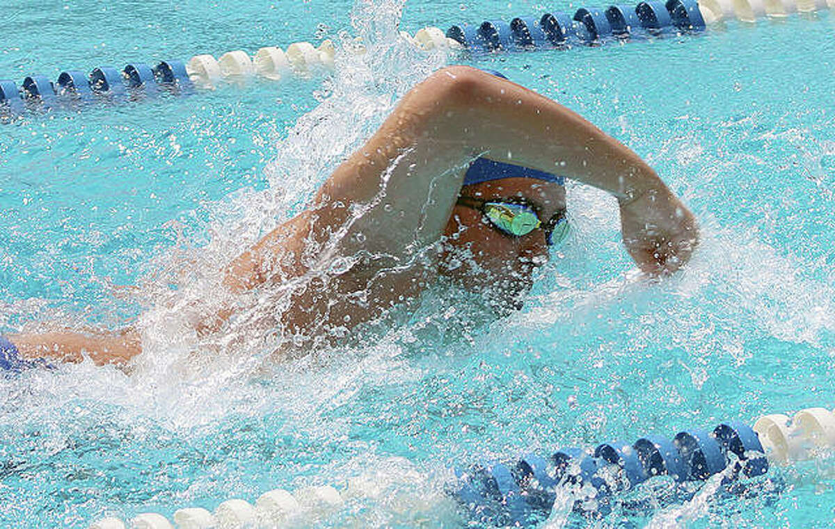 Donovan Stone of Summers Port heads for the wall during freestyle action Sunday at the SWISA Swim Championships at Summers Port Swim Club.