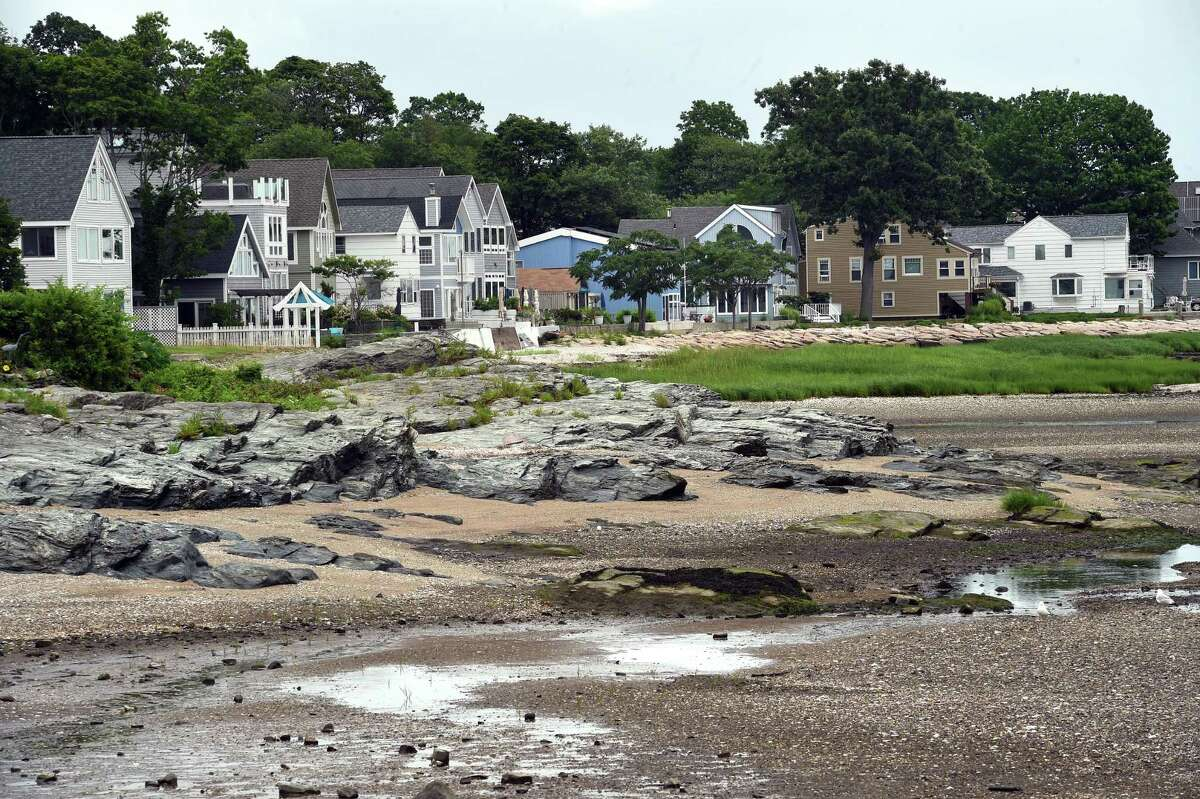 Houses hug the shoreline off of Ocean Avenue in West Haven during low tide on July 19, 2021.