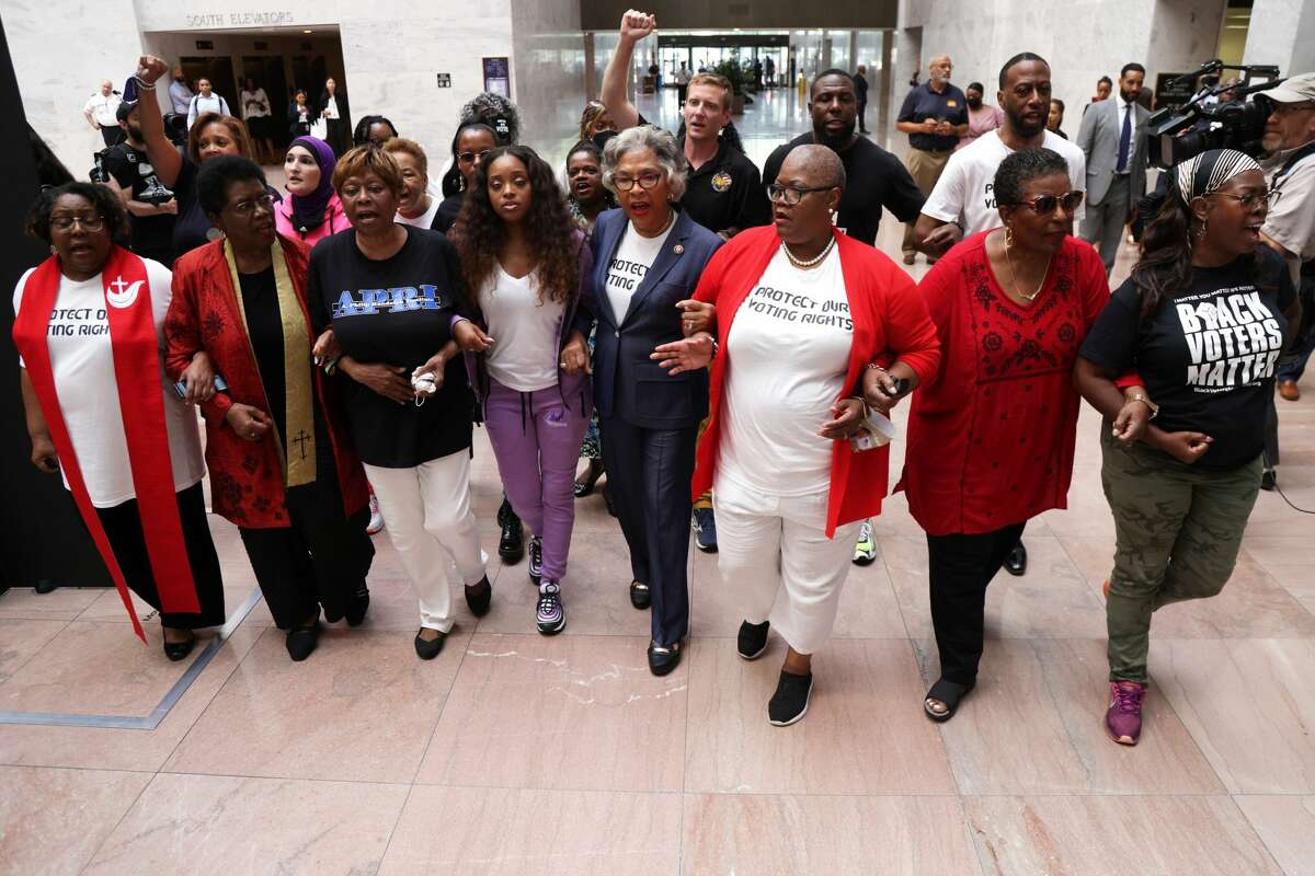 U.S. Rep. Joyce Beatty, D-Ohio, center, was one of nine arrested last week during a protest on U.S. Capitol Grounds advocating for voting rights. Kimiya Factory, a 22-year-old San Antonio activist, was among those arrested.