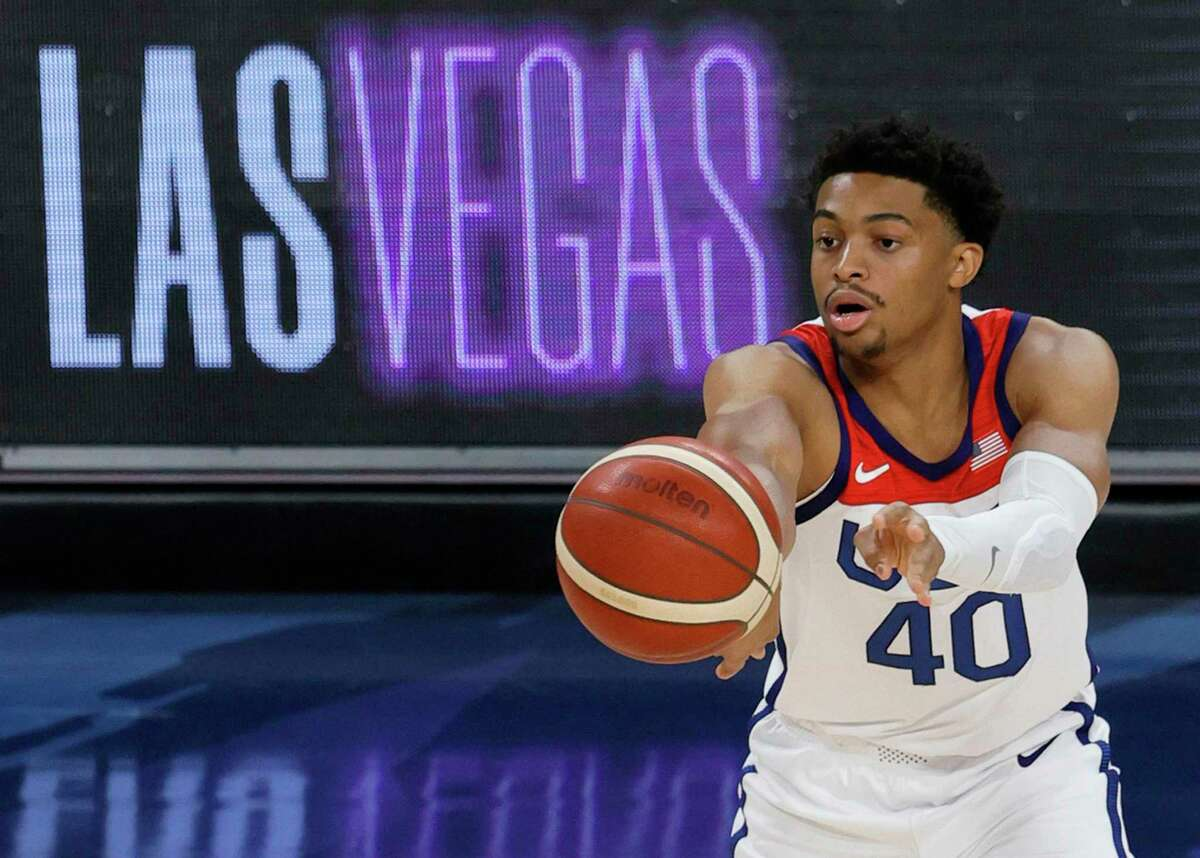 LAS VEGAS, NEVADA - JULY 18: Keldon Johnson #40 of the United States passes against Spain during an exhibition game at Michelob ULTRA Arena ahead of the Tokyo Olympic Games on July 18, 2021 in Las Vegas, Nevada. The United States defeated Spain 83-76. (Photo by Ethan Miller/Getty Images)