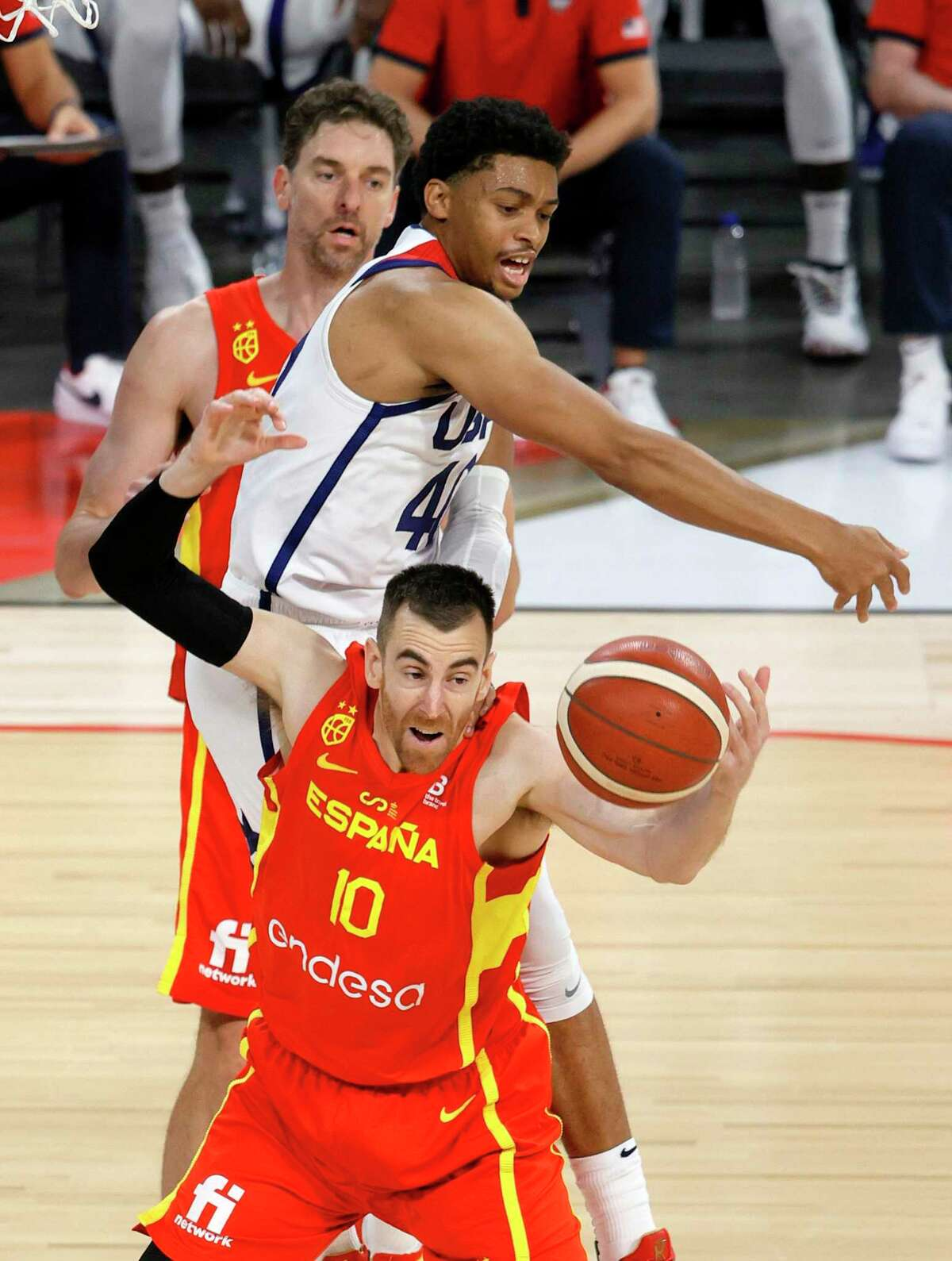 LAS VEGAS, NEVADA - JULY 18: Keldon Johnson #40 of the United States and Victor Claver #10 of Spain fight for a rebound during an exhibition game at Michelob ULTRA Arena ahead of the Tokyo Olympic Games on July 18, 2021 in Las Vegas, Nevada. The United States defeated Spain 83-76. (Photo by Ethan Miller/Getty Images)
