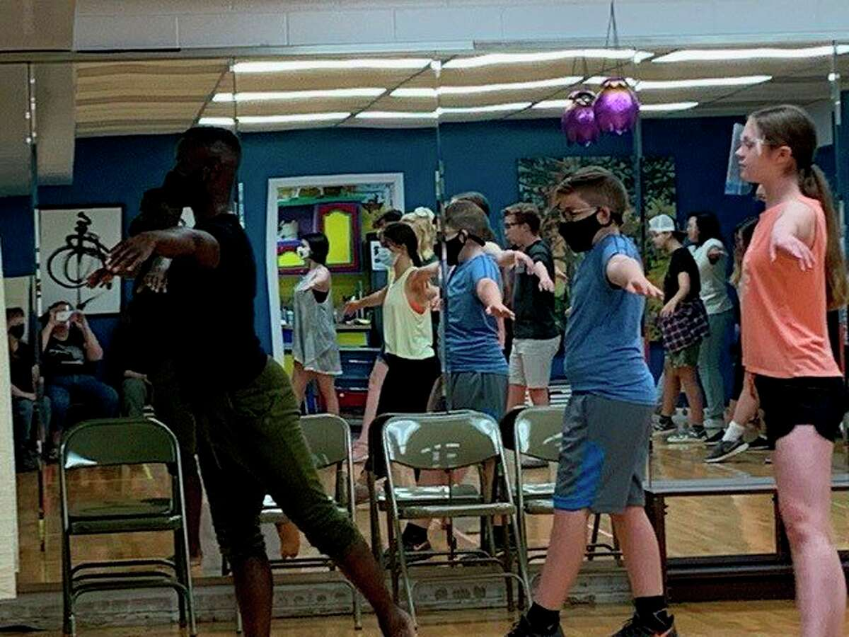 Young actors from Teenage Musicals, Inc. recently participated in a dance workshop with Broadway artist James T. Lane.  (Photo provided)
