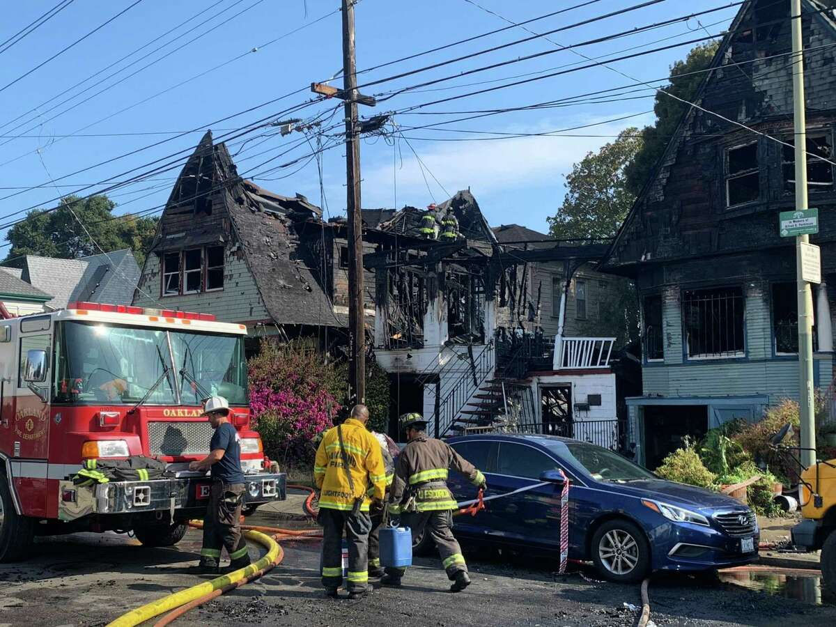 Oakland firefighters battled a three-alarm fire in West Oakland that destroyed three homes.