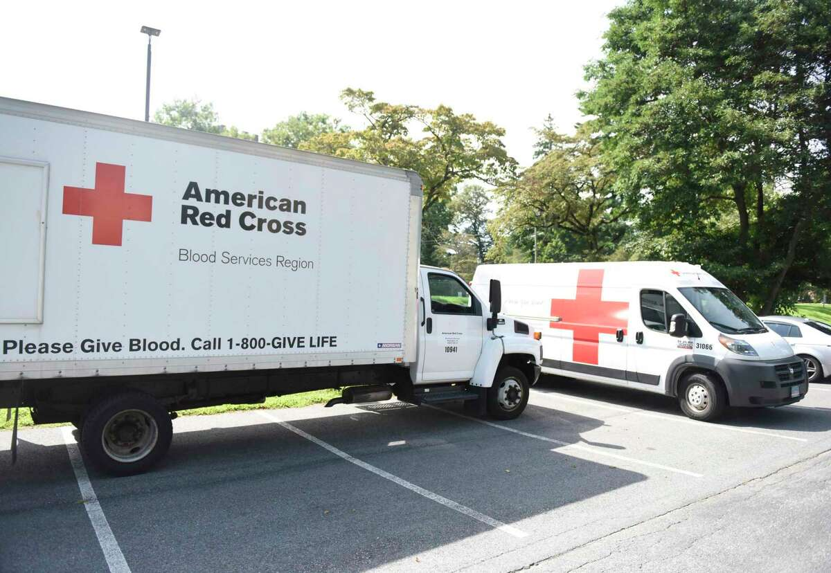 American Red Cross vehicles are parked outside the Blood Drive at Temple Sholom in Greenwich, Conn. Monday, Aug. 5, 2019. Prospective donors can make an appointment by using the Red Cross Blood Donor App, visiting RedCrossBlood.org, or calling 1-800-RED CROSS (1-800-733-2767).
