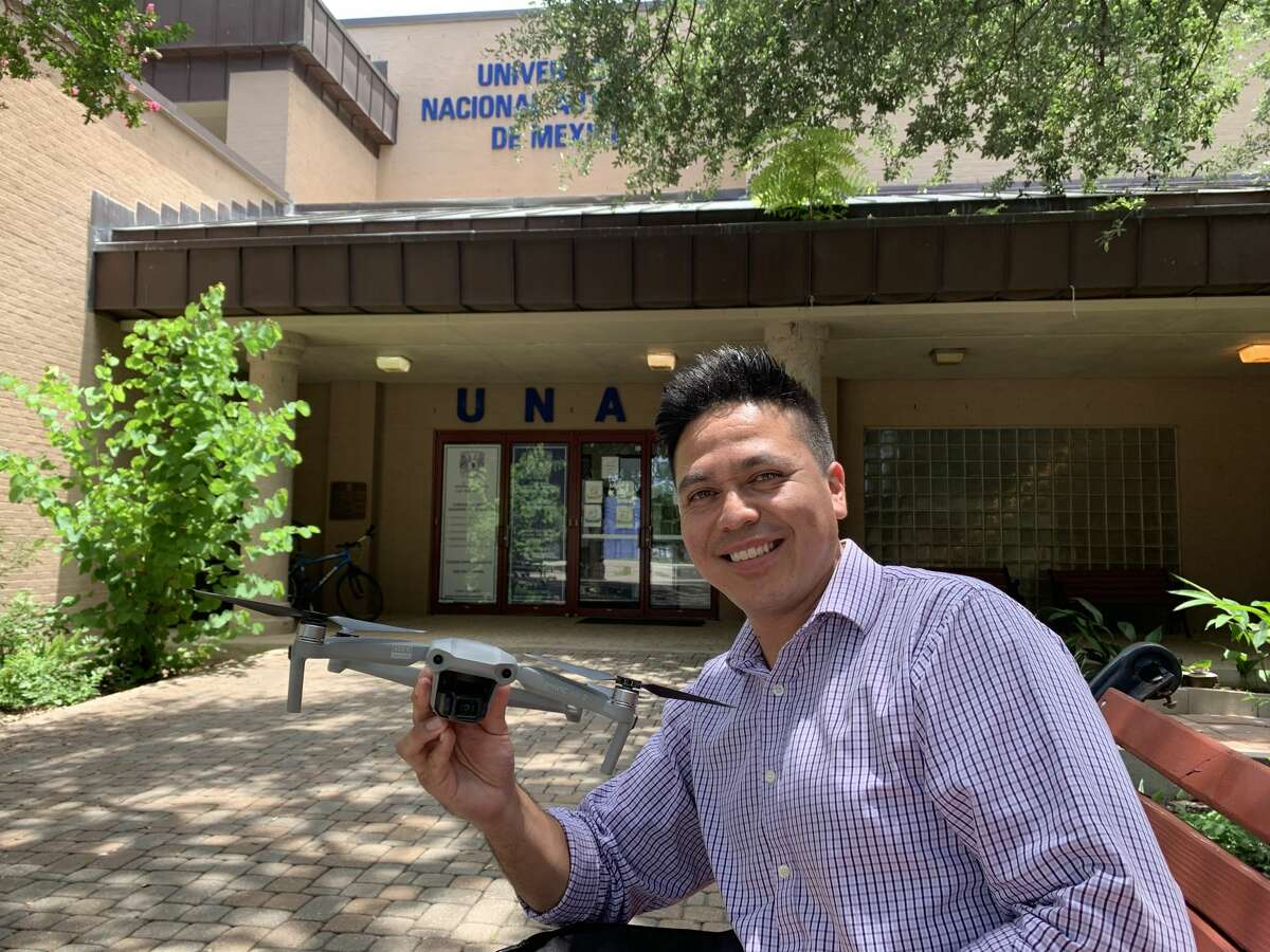 Gabriel Chavez Zekua poses with his FVB drone in front of the UNAM campus in Hemisfair.