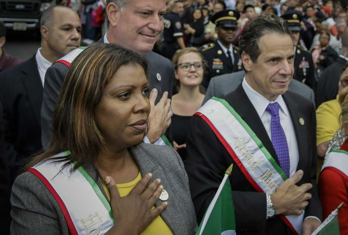 Andrew Cuomo stands with Letitia James in 2014.