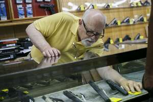 FIie photo. Customers are served at Bob's Gun Shop in Norfolk, Virginia, on June 11, 2020.