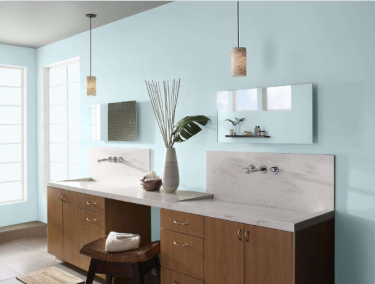A bathroom painted pale sky blue