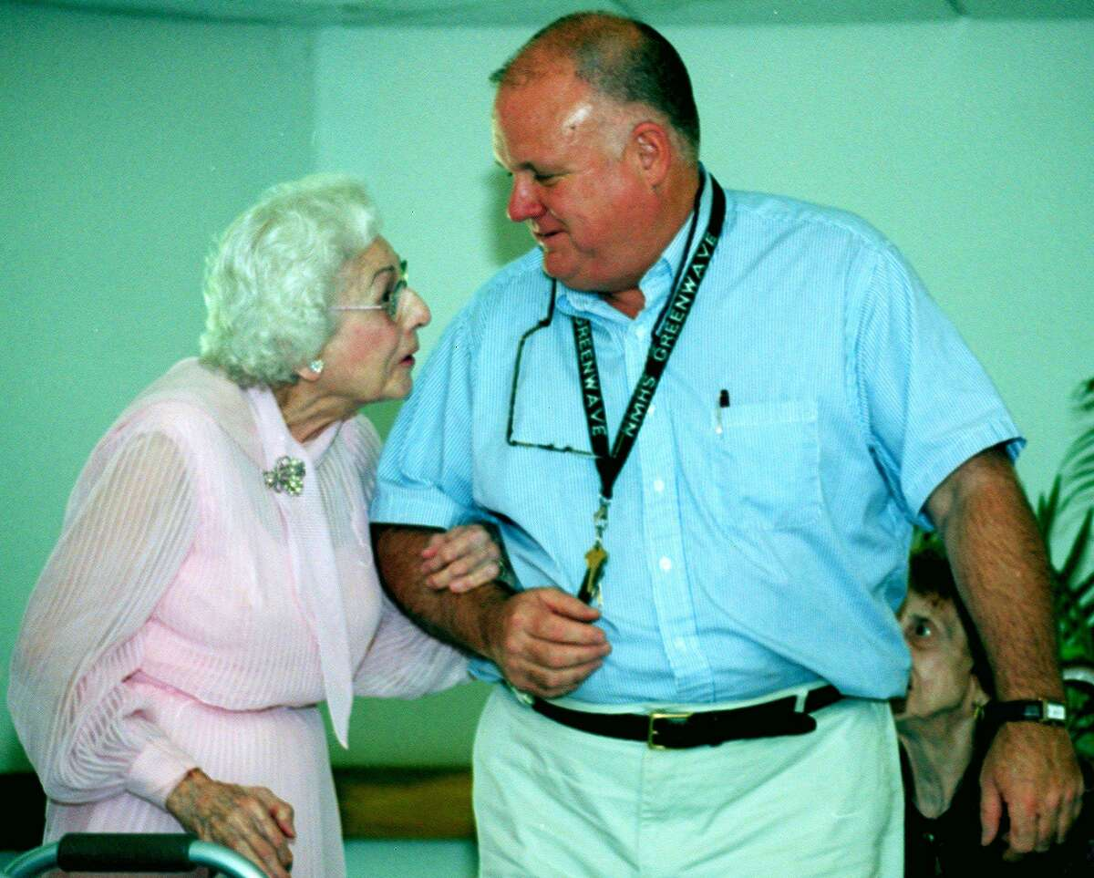 Brooks Temple and woman at bridal fashion show at Chestnut Grove elderly housing in New Milford, June 2003