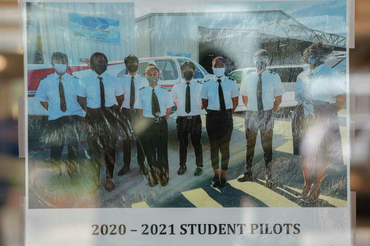 Sterling High School 2020 - 2021 Student Pilots photo hangs on a wall outside the aviation classroom Wednesday, July 14, 2021, in Houston.