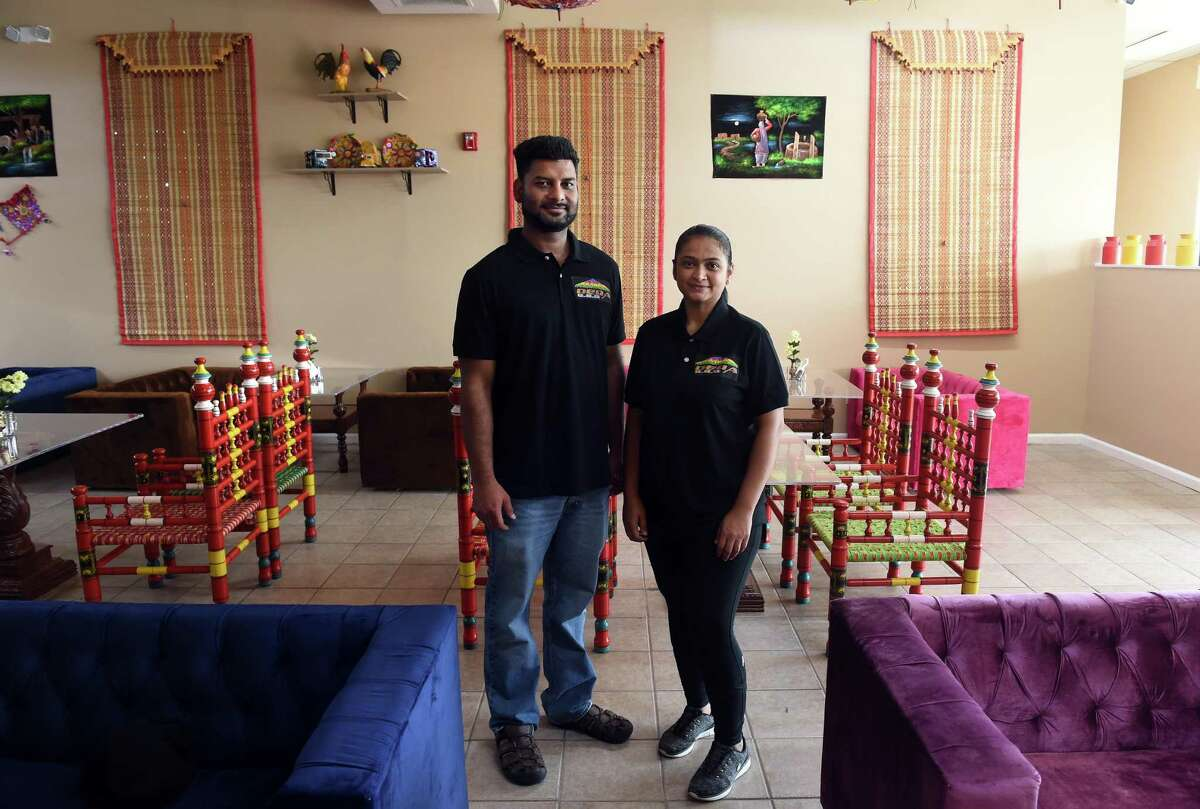 Muhammad Haroon and his wife, Neelem, are photographed at their new restaurant, Dera BBQ, in Orange on July 15, 2021.
