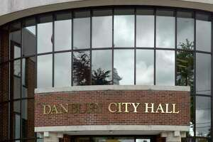 """SeanPaul Reyes led a protest, originally billed as a """"press conference"""" in front of and in the main lobby of City Hall where he and his supporters streamed live video from their phones. Monday, July 19, 2021, in Danbury, Conn."""