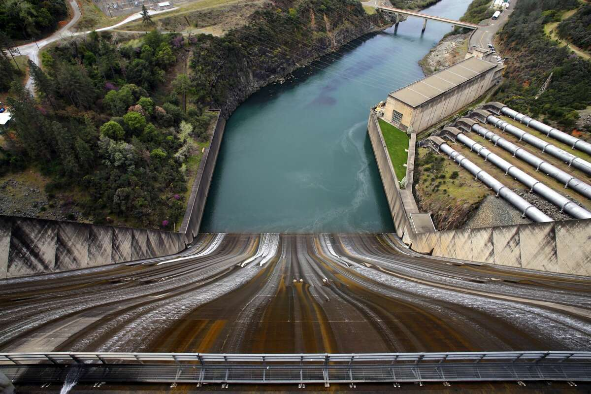 A view down the spill of the Shasta Dam into the Sacramento River in Shasta Lake, California, on Wednesday.  April.  4, 2018. The Trump administration and Republicans want to increase the height of Shasta's dam.