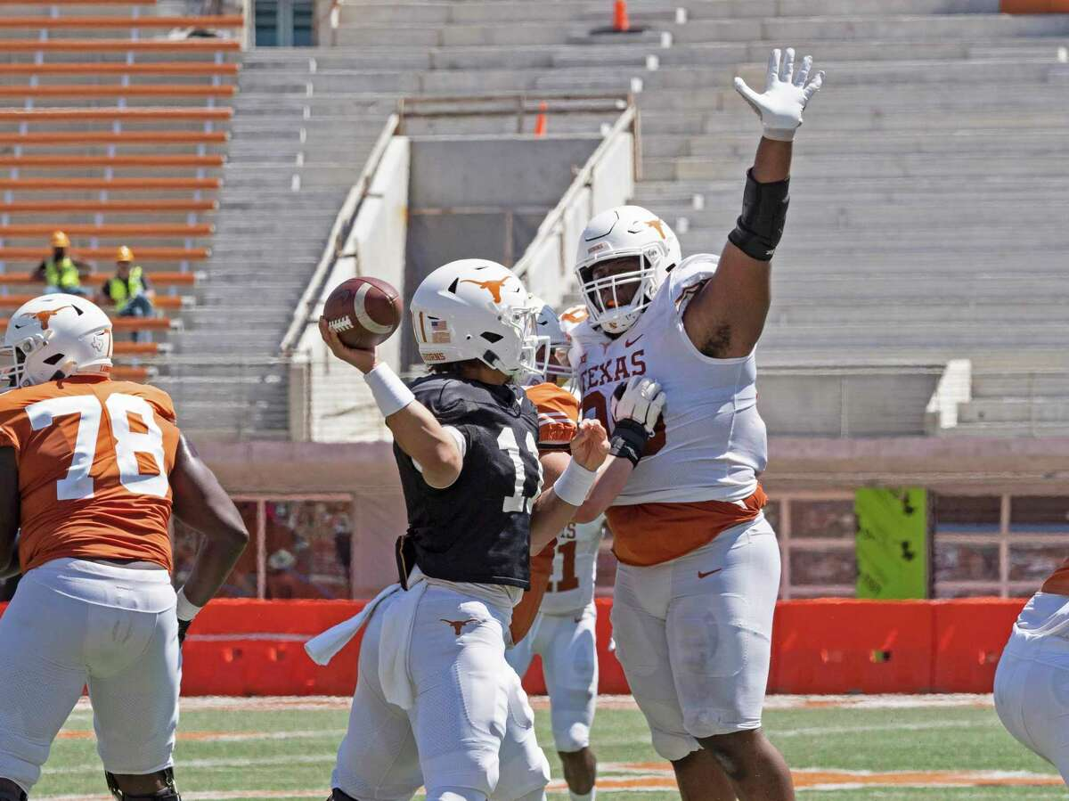 Texas defensive lineman Keondre Coburn tries to block a pass by quarterback Casey Thompson during the second half of the Texas Orange and White Spring Scrimmage in Austin, Texas, Saturday, April 24, 2021. (AP Photo/Michael Thomas)