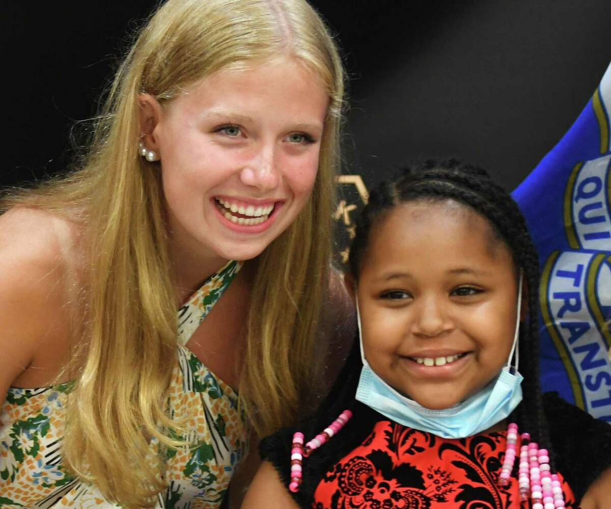 Norwalk lifeguard Morgan Saunders, 17, left, meets with Alexis Rowe, 9, the girl whose live she saved, during a ceremony at the Norwalk Police Department in Norwalk, Conn. Monday, July 19, 2021. Saunders saved Rowe from drowning at Calf Pasture Beach late last month and was honored with a cilivian award for her heroic action on Monday.