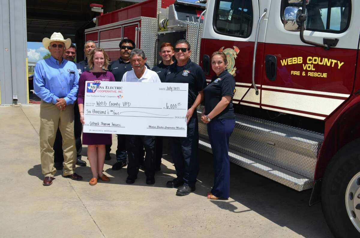 Pictured are J.L. Gonzalez and Katy Haby of Medina Cooperative, Webb County Volunteer Fire Chief Rick Rangel, Araceli Solis and members of the fire department.