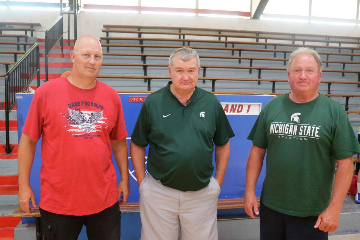 Tom Dunn of Jonesville, All Schrauben of Portland St. Patrick and Manistee Catholic Central coach Todd Erickson (pictured, left to right) have been bringing their basketball teams to Manistee Catholic's camp since it first started in 1999.