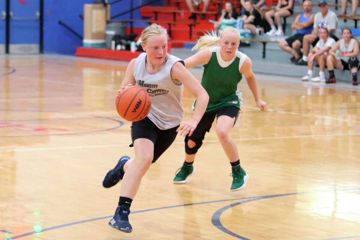 Manistee Catholic Central's Grace Kidd drives toward the basket during a scrimmage against Portland St. Patrick on July 18. (Robert Myers/News Advocate)