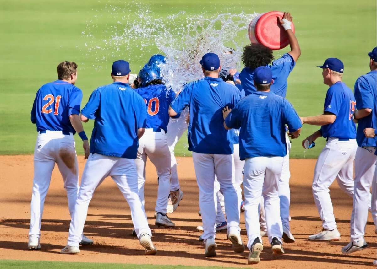 Midland Rockhounds players celebrate after completing the 11-10 comeback win versus Amarillo in the bottom of the 10th inning on 7/18/21 at Momentum Bank Ballpark.
