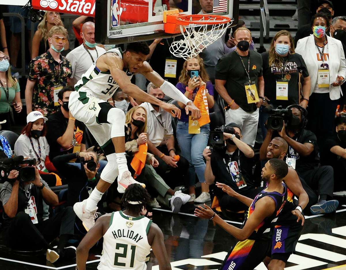 Giannis Antetokounmpo's alley-oop jam sealed Milwaukee's 123-119 win over the host Suns in Game 5 on Saturday.