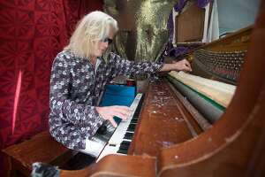 Mr. Brandy plays a piano inside the back of his Sprinter van busking pedestrians passing by in the Haight-Ashbury of San Francisco, Calif. on July 16, 2021.