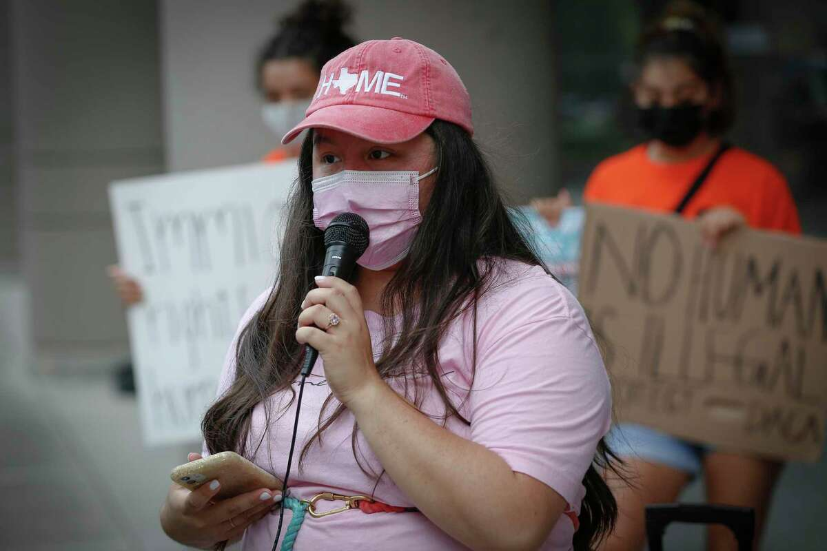 Susie Lujano talks about being a DACA recipient during a press conference and rally, organized by United We Dream outside the downtown U.S. District Court building Monday, July 19, 2021, in Houston.